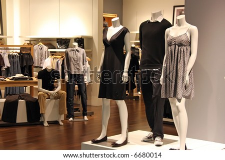 Fashion clothing retail display clothes for sale - stock photo