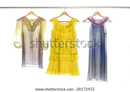Fashion colorful clothing on display - stock photo