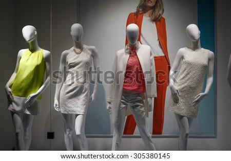 Fashion concept. Photo four elegant female mannequins demonstrating clothes. - stock photo