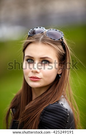 Fashion concept. Portrait close up of young beautiful fashionable brunette woman.  City lifestyle. Female fashion.