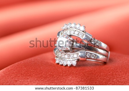 Fashion concept with ring on background - stock photo