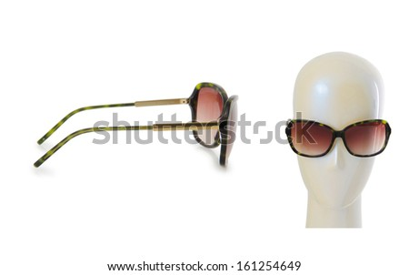 Fashion concept with sunglasses on white