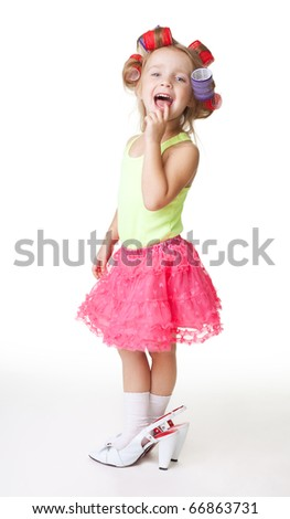 fashion-conscious little girl with mothers rollers and big size shoes - stock photo