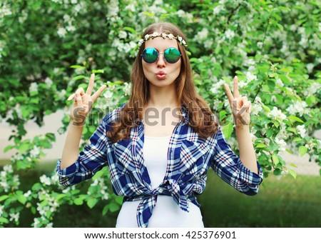Fashion cool hippie woman having fun in a flowering garden - stock photo