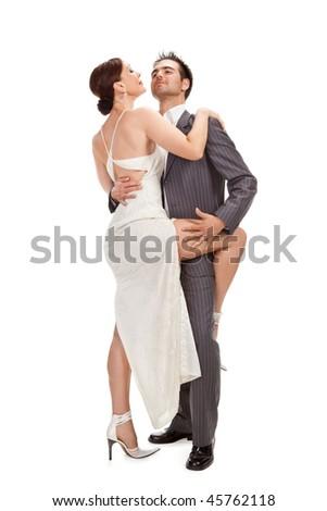 fashion couple dancing, studio shot isolated on white - stock photo