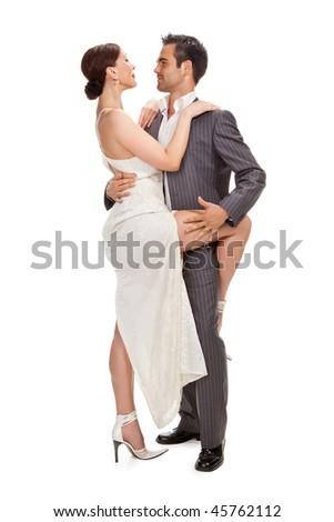 fashion couple dancing, studio shot on white - stock photo