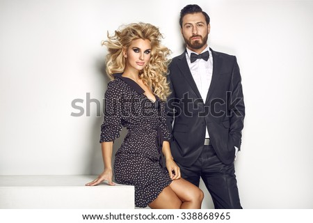 Fashion couple looking at the camera - stock photo