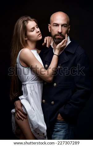 Fashion Couple on black background, Dramatic image shot - stock photo