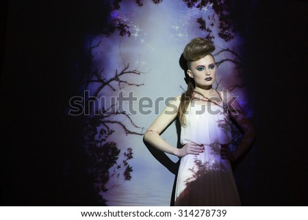 Fashion, creative portrait, woman with color image on her face and body. Image projection.
