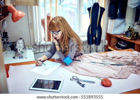 Fashion designer drawing sketches in studio
