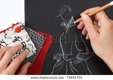 Fashion designer is drawing a fashion model - stock photo
