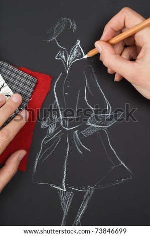 Fashion designer is drawing a fashion sketch