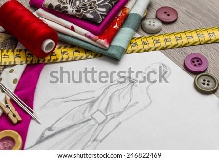Fashion designer studio with equipment - stock photo