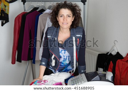 Fashion designer woman smiling to the camera looking to the camera