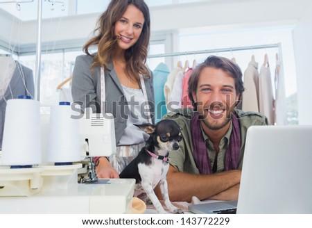 Fashion designers and chihuahua looking at camera - stock photo