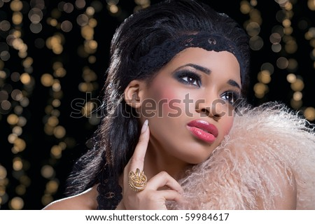 Fashion diva: young beautiful sexy woman at a party - stock photo