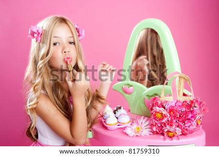 fashion doll girl with lipstick makeup in pink vanity - stock photo