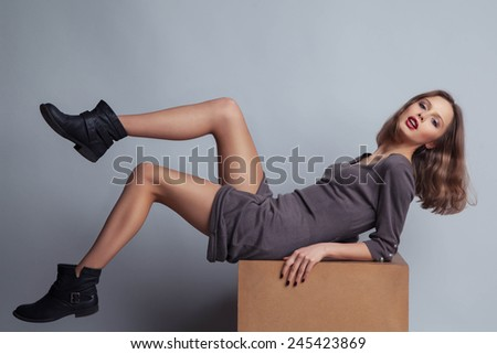 Fashion Dressed Sexy Girl Sitting on Chair. Full length Portrait.  - stock photo