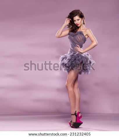 Fashion Dressed Sexy Girl. Woman in Purple Dress and High pink Heels  - stock photo