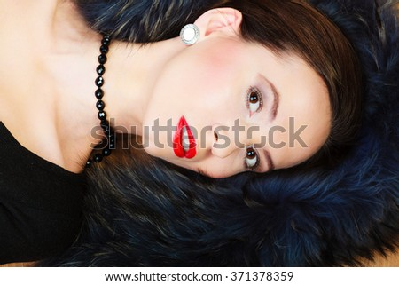 Fashion elegance and beauty. Woman in fur coat beautiful face makeup red lips, lady retro style portrait