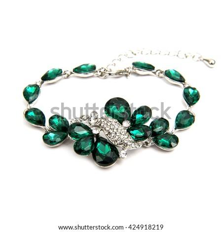 Fashion emerald bracelet isolated on white - stock photo