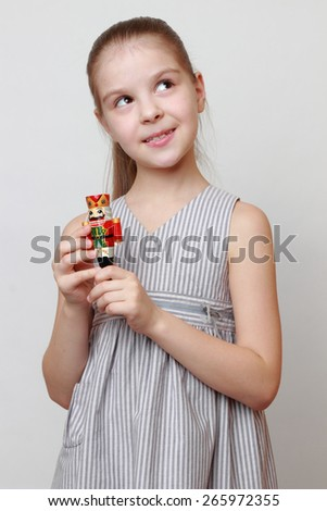 Fashion european little girl holding nutcracker toy from ballet on Christmas - stock photo