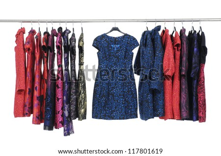 Fashion evening gown and coat clothing on hanging rack display