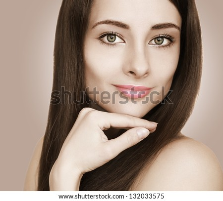Fashion female model looking sexy with hand at beauty face. Closeup portrait - stock photo