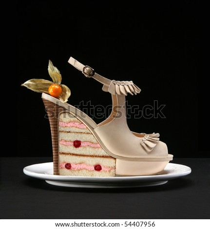 Fashion female shoes and cake - stock photo