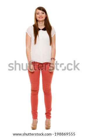 Fashion. Full length of attractive teenage girl young woman wearing fashionable white shirt with black collar isolated. - stock photo