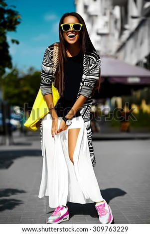 Fashion funny  glamor stylish sexy smiling  beautiful  young woman model in hipster summer clothes  walking in the street with shopping bright yellow bag - stock photo
