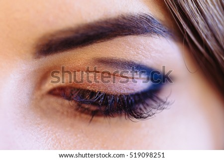 Fashion ginger woman eye makeup. Close-up macro. Beauty concept.