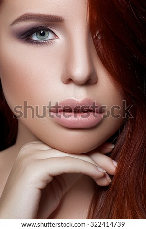 Fashion ginger woman with beautiful face - isolated on black. Skin care concept.