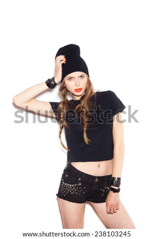 Fashion girl hipster with two long braids. Woman in black clothes. White background, not isolated - stock photo