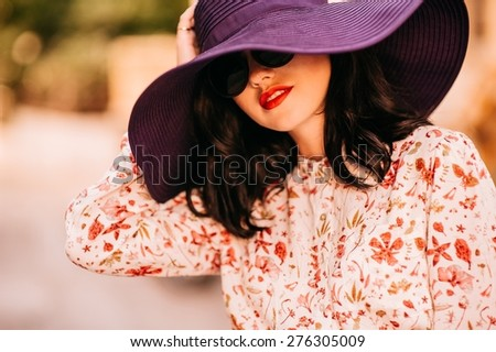 Fashion girl in a big hat - stock photo