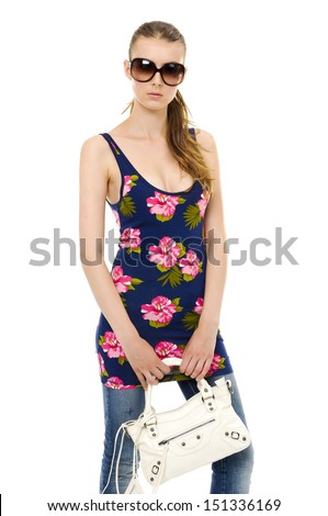 fashion girl in sunglasses and in jeans ,bag posing