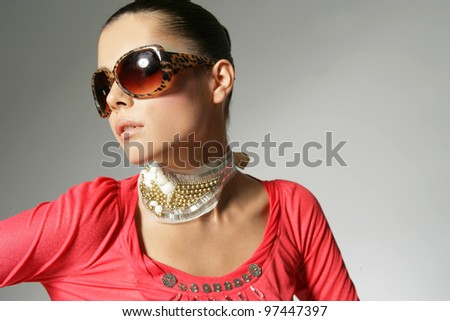 fashion girl in sunglasses on gray background - stock photo
