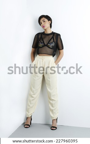 Fashion girl model posing on white background in the studio.  - stock photo