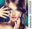 Fashion Girl Portrait    Girl with trendy turquoise makeup . . Jewelry earrings and    bijouterie  accessories - stock photo
