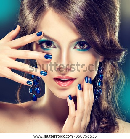 Fashion Girl Portrait    Girl with trendy turquoise makeup . . Jewelry earrings and    bijouterie  accessories
