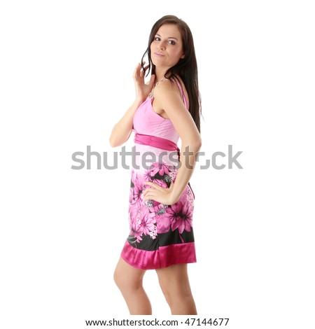 Fashion girl posing in pink dress on white background - portrait