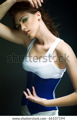 Fashion girl posing on dark background - stock photo