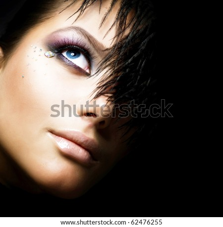 Fashion Girl's Face.Perfect makeup.Isolated on Black - stock photo