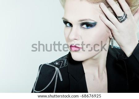 Fashion girl straightens her hair - stock photo