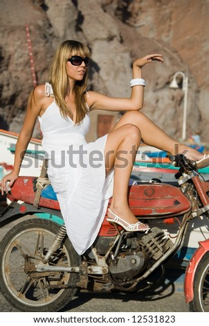 Fashion girl wearin white dress in a motocycle - stock photo