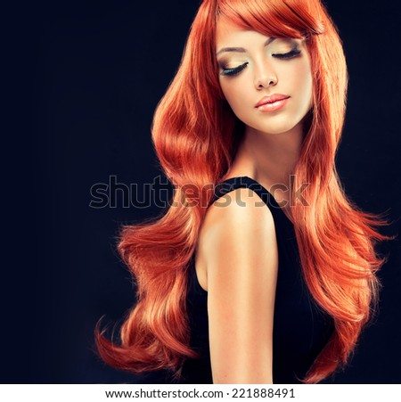 Fashion Girl with beautiful and shiny red hair - stock photo