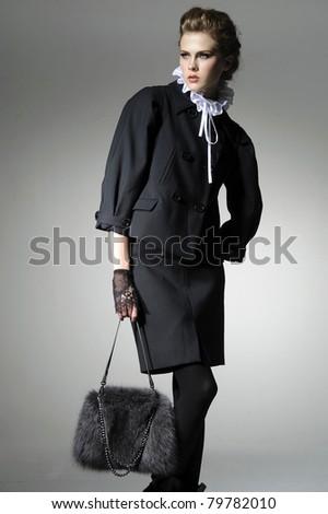 Fashion girl with handbag posing - stock photo