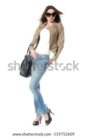 Fashion girl with handbag posing over white background - stock photo