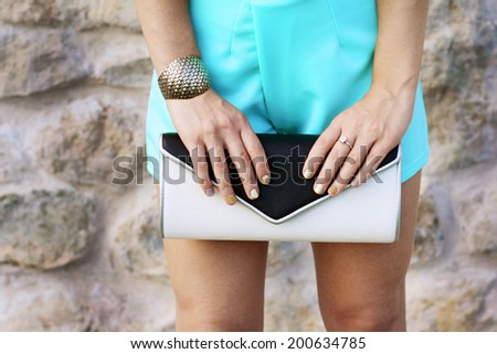 fashion girl with stylish white back clutch and accessories - stock photo