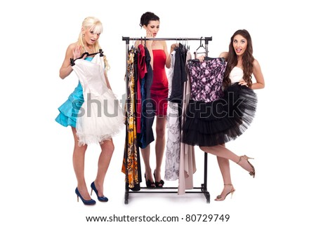 fashion girls choose dresses in boutique, isolated on white background - stock photo